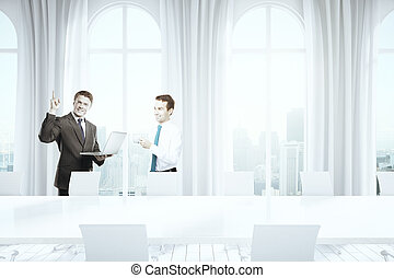 Businesspeople in conference room - Successful...