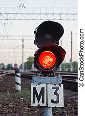 red semaphore signal on railway in summer time - red...