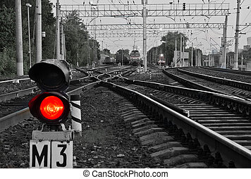 red semaphore signal on railway in the summer - red...
