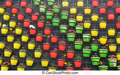 many colored flower pots on the wall