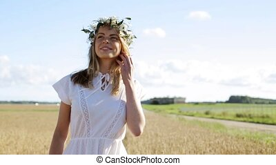 happy young woman in flower wreath on cereal field - nature,...