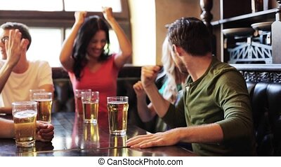 friends with beer watching football at bar or pub - people,...