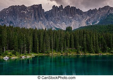 Amazing view of Lago di Carezza with wild mountain forest,...