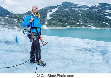 Woman climber standing on Jostedalsbreen glacier Norway