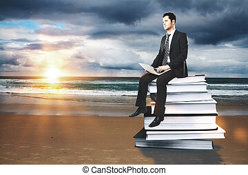 Education concept businessman on books - Businessman with...