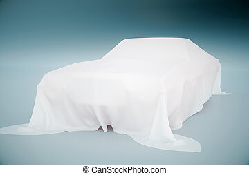 Car covered with cloth - Car covered with white cloth on...