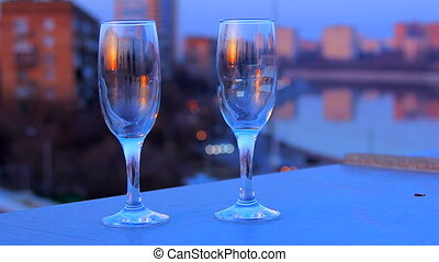 Wine glasses standing on the roof during night party - Two...