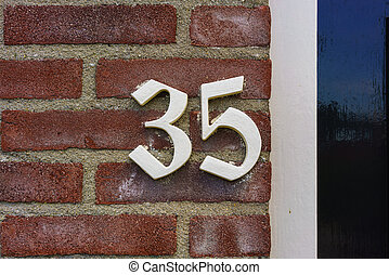 Number 35 - House number thirty five (35)