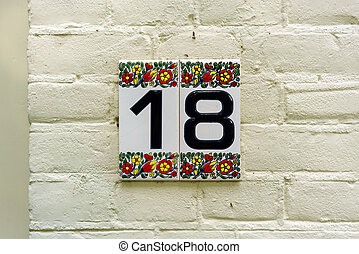 Number 18 - House number eighteen (18)