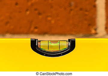 Close up of a spirit level showing horizontal with shallow...