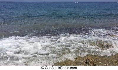 Rocky seashore breaking waves - Waves breaking on a rocky...