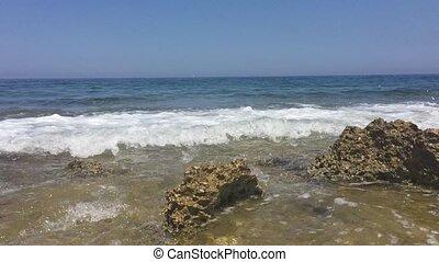 Light waves rocky seashore - Light waves breaking on a rocky...