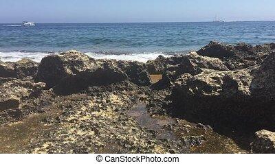 Rocky coastline in the Mediterranea - Waves breaking on a...