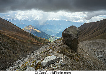 Mountain landscape with a big rock on the ridge - Mountain...