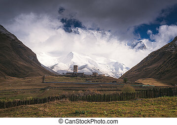 Mountain landscape with an old stone church in the valley -...