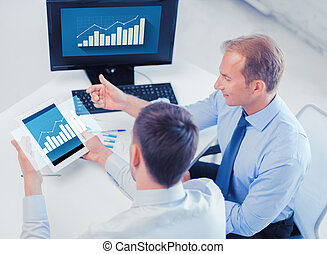 businessmen with tablet pc and computer at office -...
