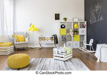 Interior of baby room with trendy blackboard wall