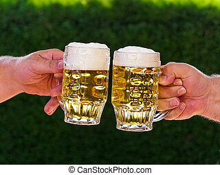 Two pitchers of beer to us beer foam - Two pitchers of beer...