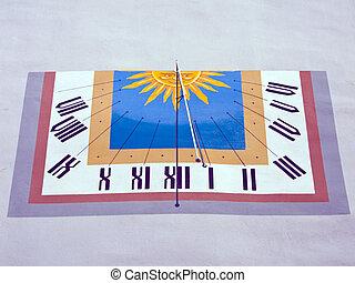 Sundial on a house facade