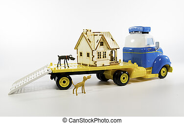 Moving house on trailer with two dogs isolated on white...