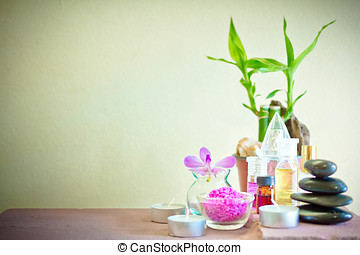 Spa composition with candle, pebbles and aroma oil.