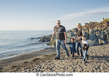 Family having great time ocean - A Family having great time...