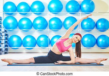 woman stretching in gym - fitness, sport, training, gym and...