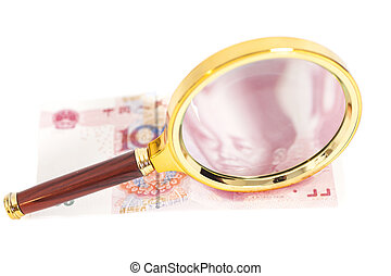 100 yuan chinese money with magnifier glass isolated on...