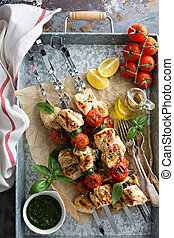 Chicken kabobs on a tray - Chicken kabobs with tomatoes and...