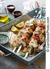 Chicken kabobs on a tray