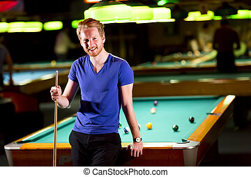 Man with snooker stick - Portrait of a young man playing...