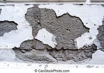 Old wall with damaged plaster layer