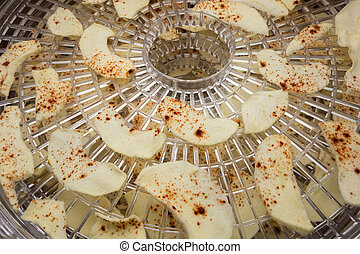 Drying fruits concept - Chopped apples with cinnamon on...