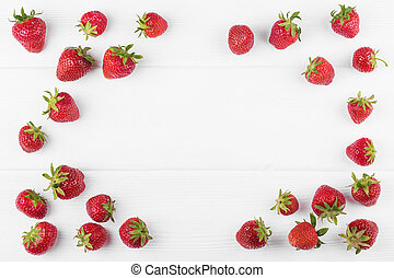 Strawberry with green leaf on white wooden background -...