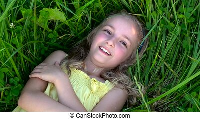 cute girl on grass - cute girl lying on grass