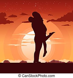 silhouette of loving couple in hug at sunset