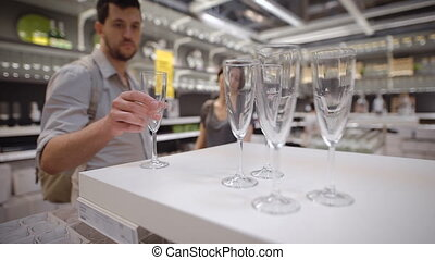 A newly married couple choosing glasses - A happy newly...