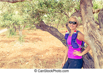 Happy woman runner relaxing