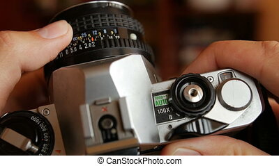 Old camera in hands - Old mechanical camera in hands....