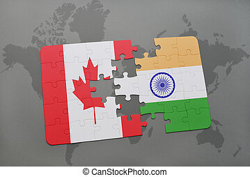 puzzle with the national flag of canada and india on a world map background.