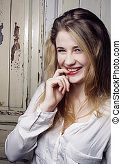 young pretty blond teenage happy smiling girl close up...
