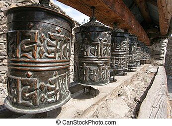 Buddhist many prayer wheels - view of Buddhist many prayer...