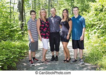 family on forest having great time - A family on forest...
