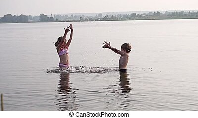 kids playing in water slow motion