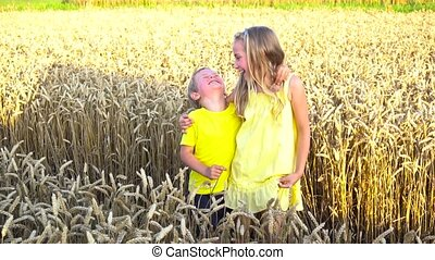 kids posing in wheat field - cute kids posing in wheat field