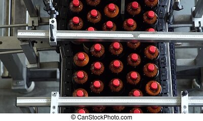 The conveyor belt production of beer in PET plastic bottles....