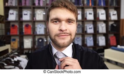 Fashion Man In Suit Posing In Wear Shop - An attractive...