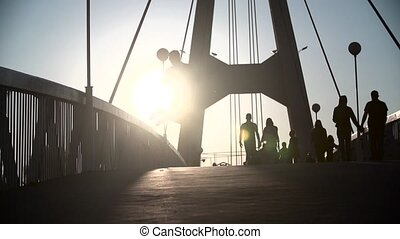Happy man in suit jumping on the bridge on sunset slowmotion