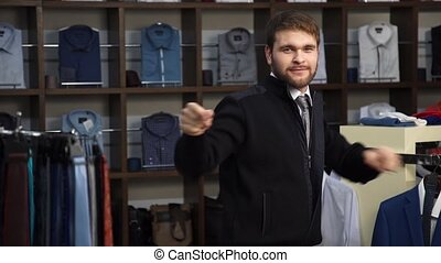 Young attractive man with a beard, dressed in a business...