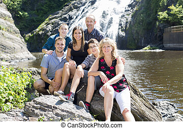 family waterfall having great time - A family in front of a...
